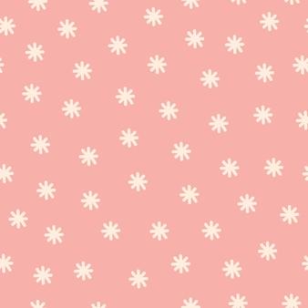 ピンクのパターンの白い雪片