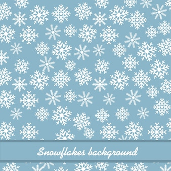White snowflakes over blue background.