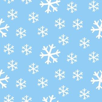 Бесшовный узор белые снежинки на синем фоне.