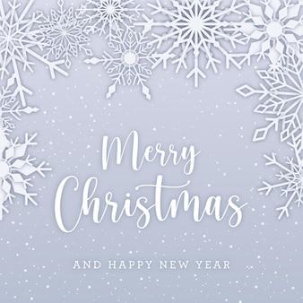 エレガントな雪片と白い雪のクリスマスカード