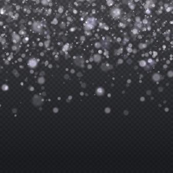 ぼやけたボケ味のメリークリスマスの白い星を輝かせるグローライト効果のある白いスパークキラキラ