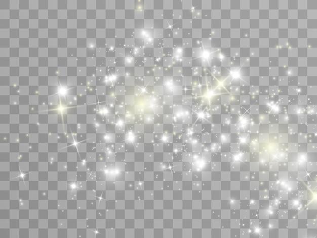 白い火花と金色の星が特別な光の効果を輝かせます。透明な背景に輝きます。
