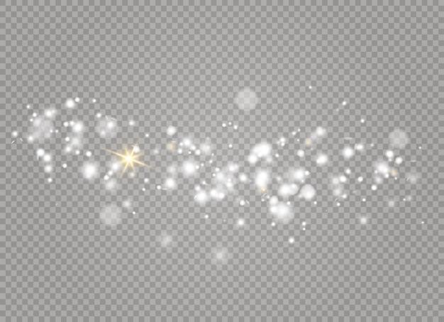 白い火花と金色の星が特別な光効果で輝きます。妖精のほこりの輝く粒子。