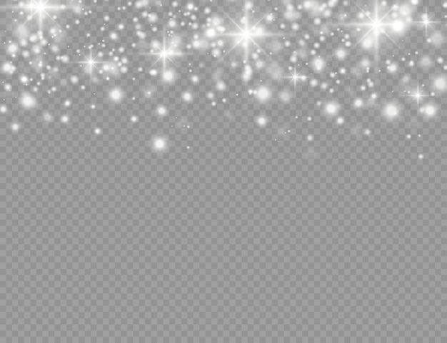白い火花と星が特別な光の効果で輝きます。妖精のほこりのきらめく粒子。