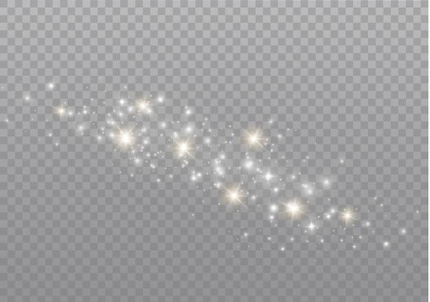白い火花がきらめく特別な光の効果。透明な背景にきらめきます。クリスマスの抽象的なパターン。きらめく魔法のほこりの粒子