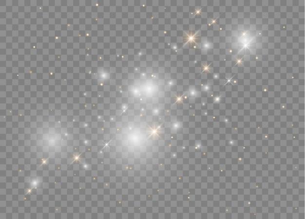 Белые искры сверкают особым световым эффектом. сверкает на прозрачном фоне. сверкающие частицы волшебной пыли.