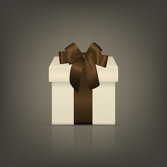 White square gift box with brown ribbon and bow
