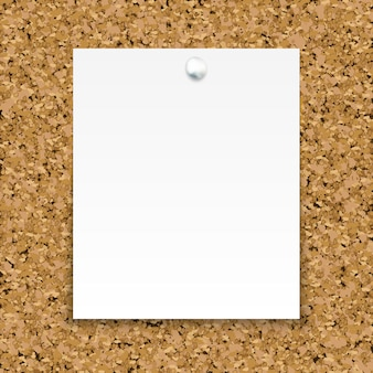 White sticky note isolated on the cork board