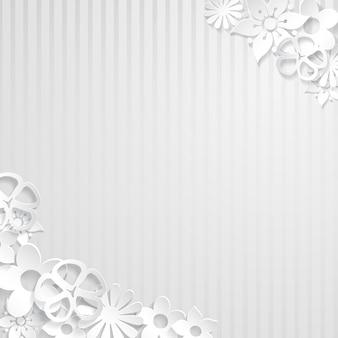 紙から切り取られた白い花と白い縞模様の背景