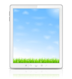 White tablet pc with green grass and blue sky on the screen Premium Vector