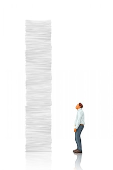 White tall paper stack vs man