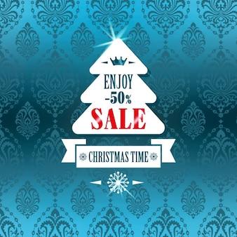 장신구와 파란색 배경에 크리스마스 판매를위한 화이트 트리
