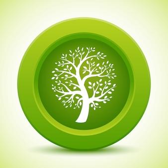 緑の丸いボタンに白い木のシルエット