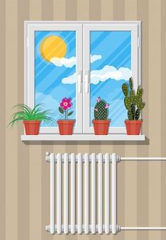 벽에 꽃과 흰색 창입니다.