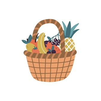 Wicker basket with fresh tropical fruits and berries isolated on a white background