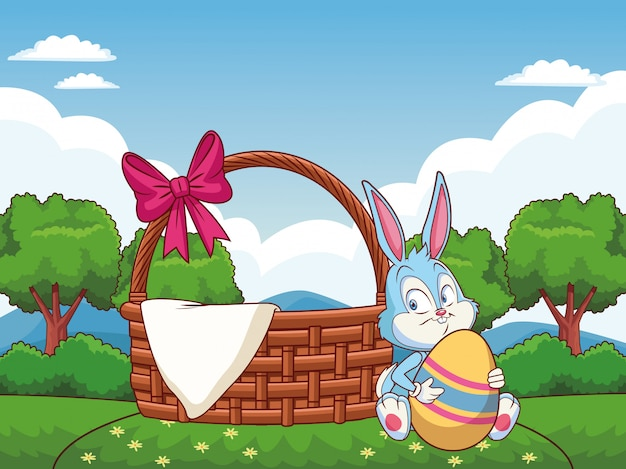 Wicker basket with ribbon and easter bunny on nature