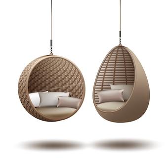 籐の吊り椅子はクッション付きのチェーンにぶら下がってスイングします