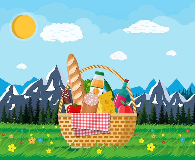 Wicker picnic basket full of products and nature