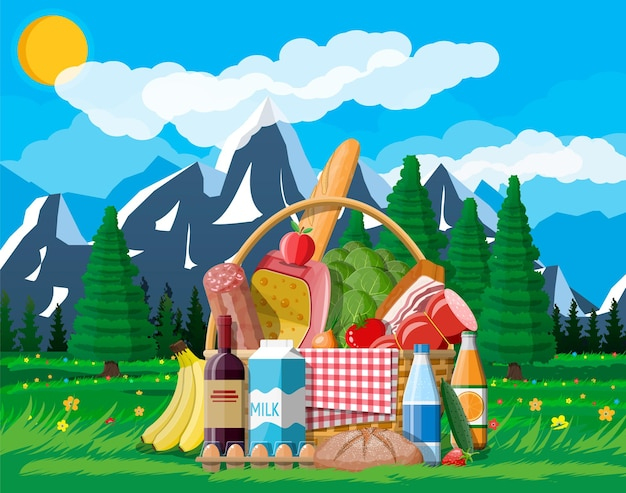 Wicker picnic basket full of products. wine, sausage, bacon and cheese, apple, tomato, cucumber, salad, orange juice