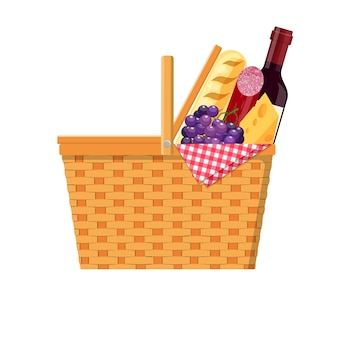 Wicker picnic basket with gingham blanket full of products.