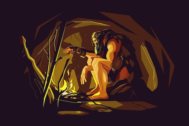 Дикий пещерный человек сидит возле костра