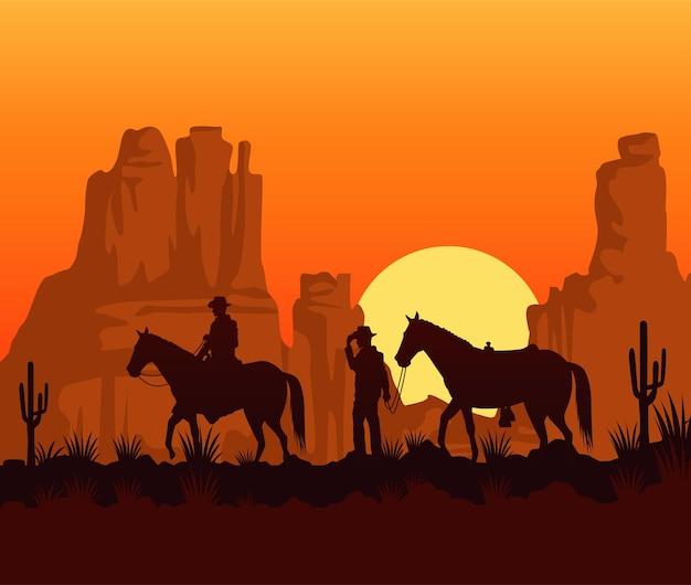 カウボーイと馬との野生の西の日没シーン