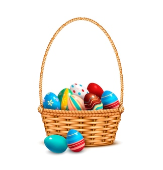 Willow wicker basket with painted colorful easter eggs