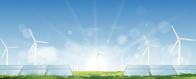 緑の芝生のフィールドでの電力生産のための風車農場とソーラーパネル