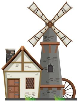 白い背景の上の納屋と風車