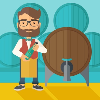 Wine maker inspecting wine from barrel.