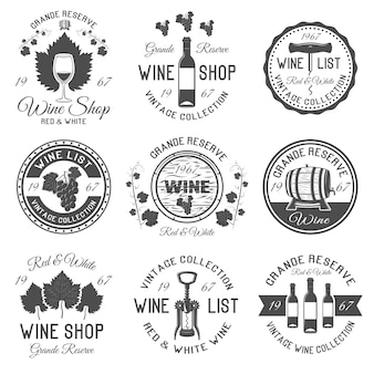 Wine shop black white emblems with leaves and bunches of grapes wooden barrels glassware isolated
