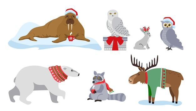 冬の動物、プレゼント、サンタ帽子、スカーフ。メリークリスマス、そしてハッピーニューイヤー。