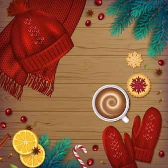 冬の背景クリスマス要素モミの枝、ニット帽、ミトン、一杯のコーヒー、クッキー