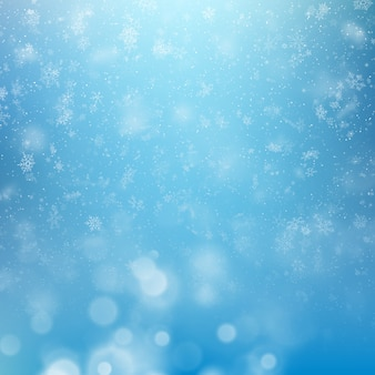 Winter background, falling snowflakes over winter bokeh template with copy space.