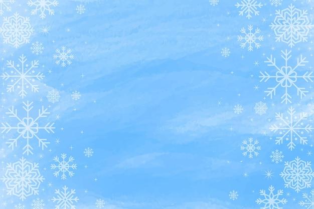 空のスペースと青い水彩画の冬の背景