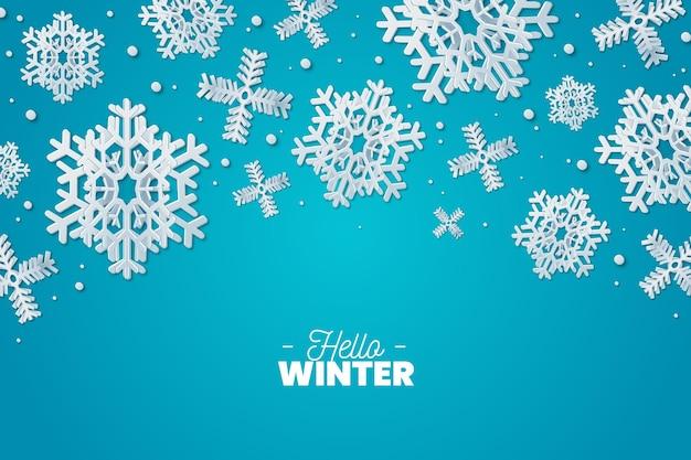 雪片と紙のスタイルの冬の背景