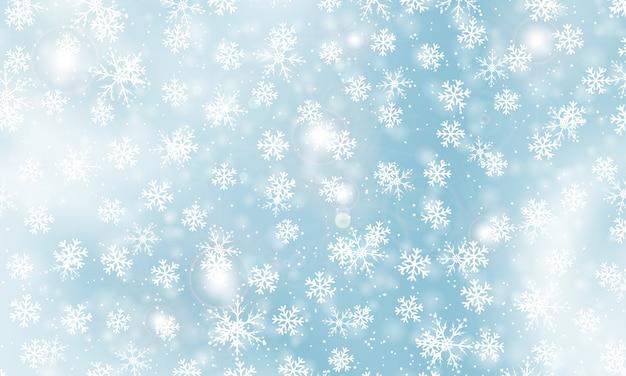 冬の背景。現実的な雪片。クリスマスの背景。雪が降る。