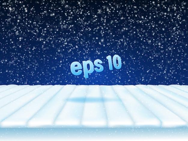겨울 배경입니다. 눈 덮인 보드로 만든 연단이있는 겨울 스튜디오가 제품을 선보입니다.