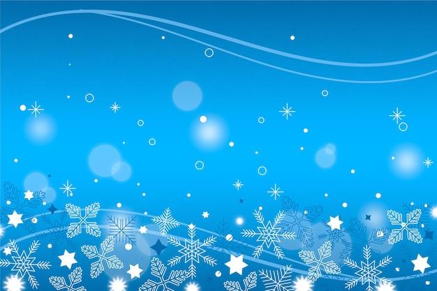 Sfondo invernale con fiocchi di neve sfocati