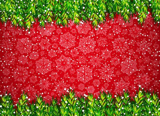 Зимний фон с ветками елки, снегом и снежинками на красном
