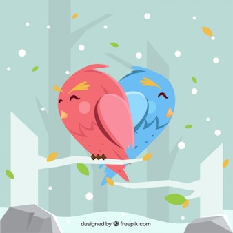 Winter background with cute birds forming a heart