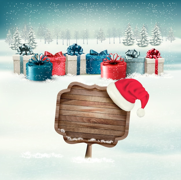 Winter background with gift boxes and a wooden ornate merry christmas sign.