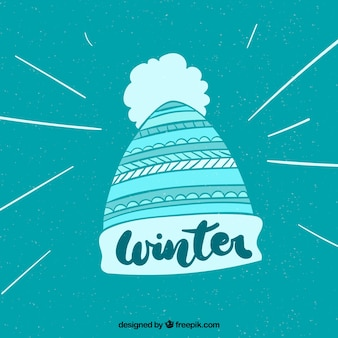 Winter background with a knitted cap