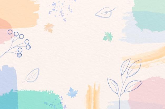 パステルカラーのブラシと葉を持つ冬の背景