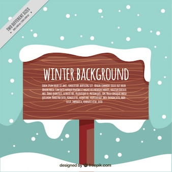 Winter background with wooden sign