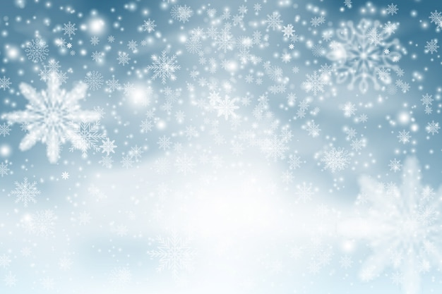Winter blue sky with falling snow, snowflake. christmas snow surface. christmas snowflakes shining