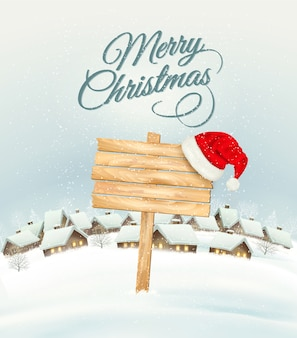 Winter christmas landscape with a wooden ornate sign background and santa hat