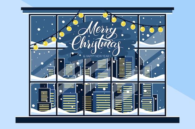 Зимнее рождественское окно с видом на заснеженный город надпись merry christmas