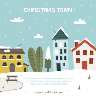 Città d'inverno con sfondo di case