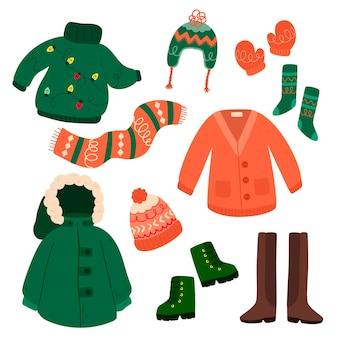 Vestiti invernali ed elementi essenziali in design piatto